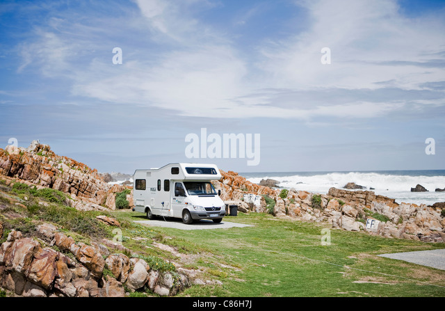 Recreational vehicle parked on beach - Stock Image