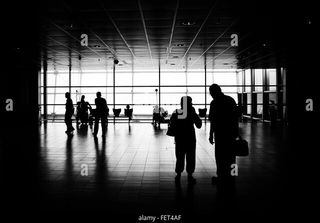 Silhouette People Standing In Airport - Stock Image