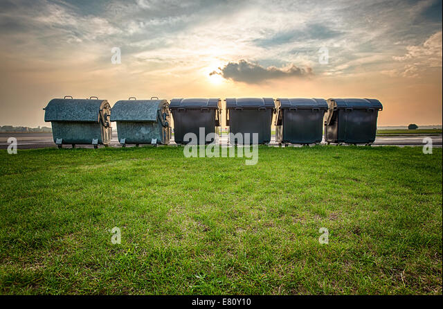 HDR shoot of some big trash can's in sunset - Stock Image