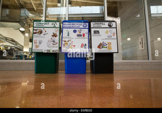 bilingual English and Spanish sign on recycling bins inside Austin Community College building - Stock Image