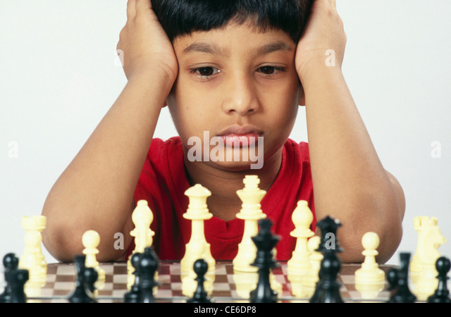 small young boy playing chess   MR#152 - Stock Image