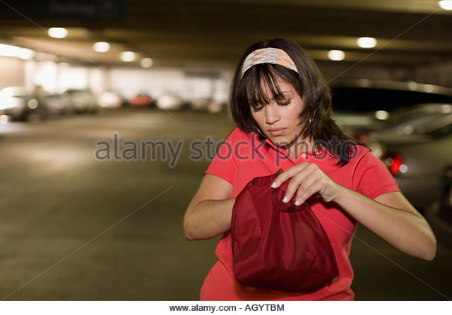 Woman searching through purse - Stock Image