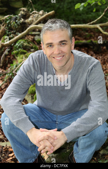 An informal location portrait of a man. - Stock Image