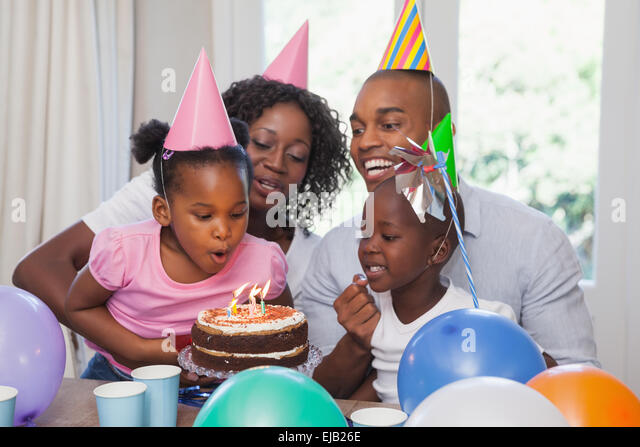 Happy family celebrating a birthday together - Stock Image