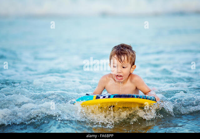 Boy learning to body surf - Stock Image