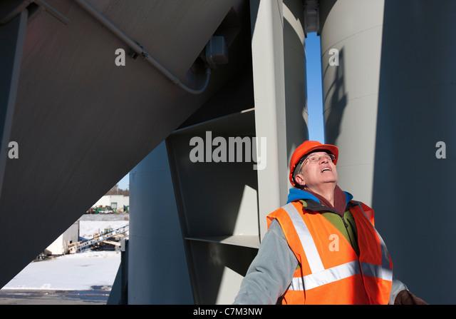 Engineer examining at a material plant - Stock Image