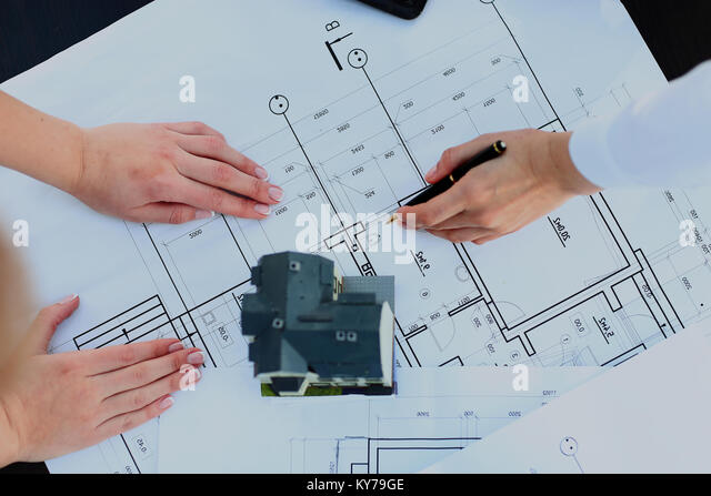 architects model house with plan and blueprints. - Stock Image