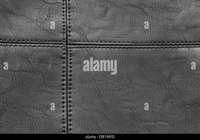 Detail of black leather with stitching in closeup - Stock Image
