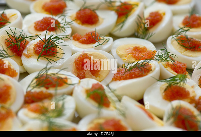 Closeup of egg and caviar on a plate - Stock Image