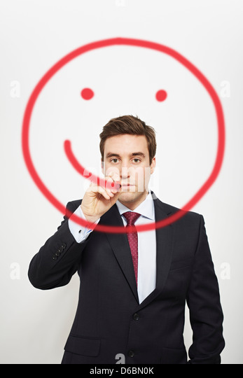 Businessman drawing smiley face in air - Stock-Bilder