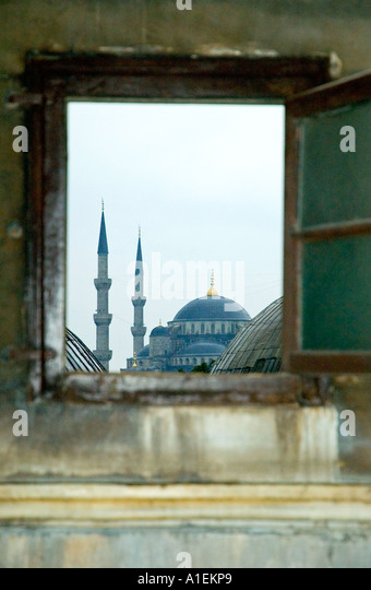 The distant Blue Mosque dome, and minarets, through a window of the Aya Sofya, Istanbul, Turkey. DSC_7384 - Stock-Bilder