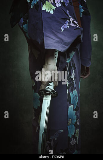 Detail of samurai sword. Woman in traditional kimono - Stock-Bilder