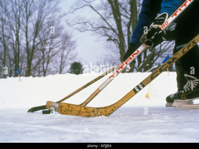 Hockey players skating with a puck - Stock Image