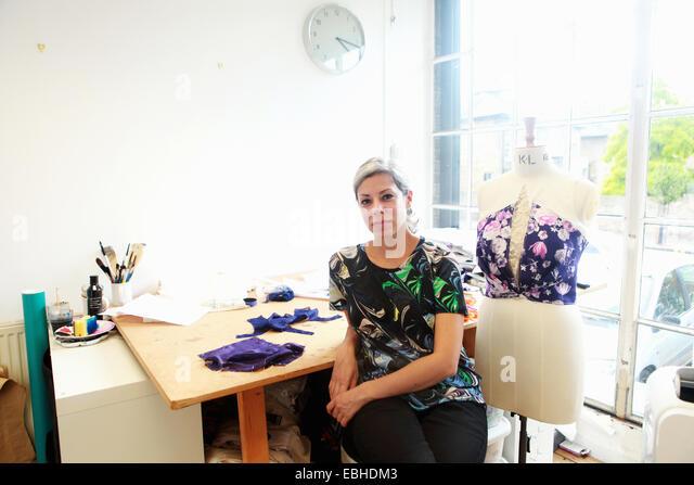 Designer in her studio - Stock Image
