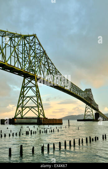 Astoria-Megler Bridge, Columbia River and wood pylons, Astoria, Oregon USA - Stock Image
