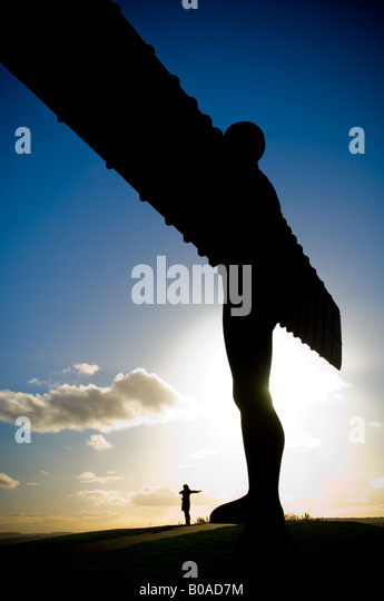 The Angel of The North modern sculpture by Anthony Gormley Gateshead UK Female figure at base with arms outstretched - Stock-Bilder