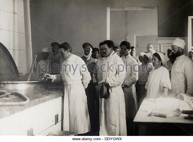 Mikhail Kalinin, Soviet politician, tasting the food in a military hospital, 1921. Artist: Pyotr Otsup - Stock Image