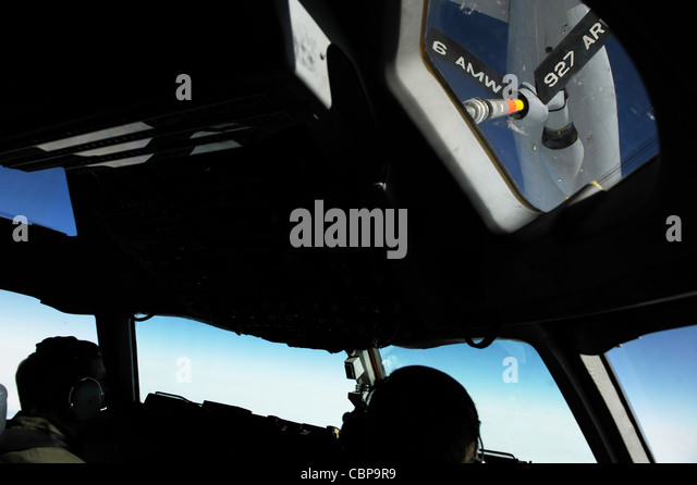 Lt. Col. Brian Loehrke maneuvers a C-17 Globemaster III into position under a KC-135 Stratotanker during an air - Stock Image