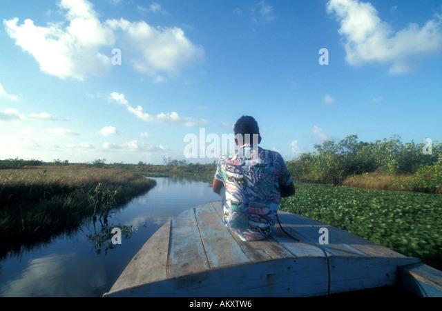 Nicaragua Miskito Coast indian boy on canoe bow - Stock Image