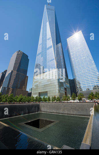 NEW YORK CITY - SEPTEMBER 4, 2016: The new One World Trade Center building stands above the National September 11 - Stock Image