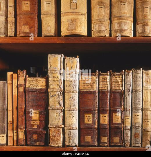 Old books on shelf - Stock Image