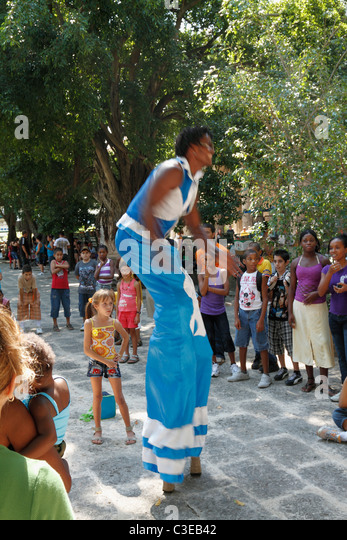 Long Leg Street Performer man dancing at street to entertain children. Havana (Habana), Cuba - Stock Image