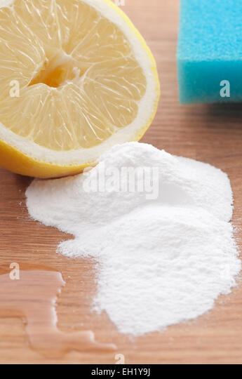 Baking soda, lemon and a sponge. Environmentally friendly cleaning ingredients. - Stock Image