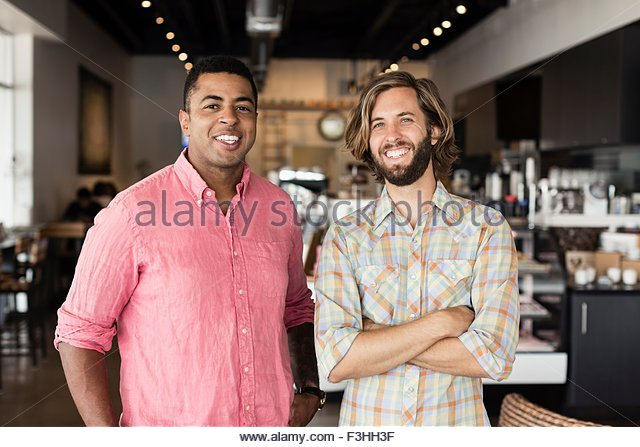 Portrait of two men in coffee shop - Stock Image