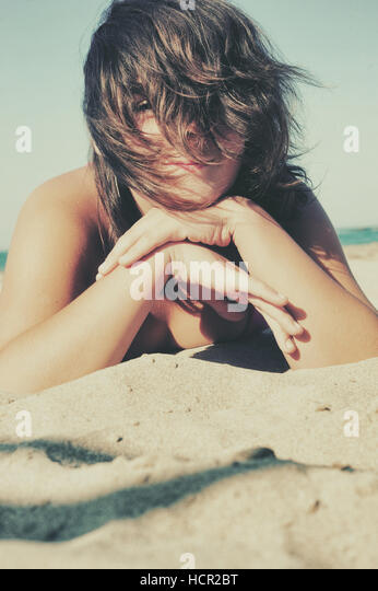 Girl resting on the beach - Stock Image