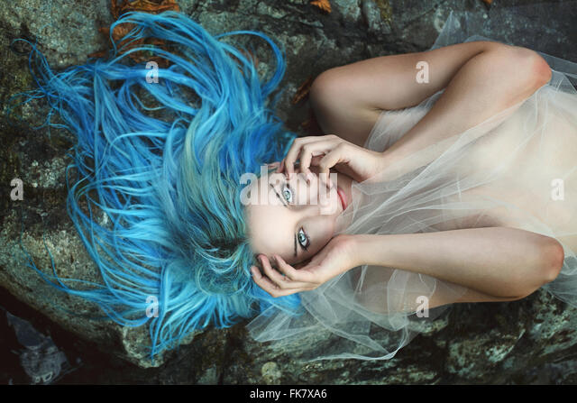 Beautiful river nymph posing on rocks . Fantasy and myth - Stock-Bilder