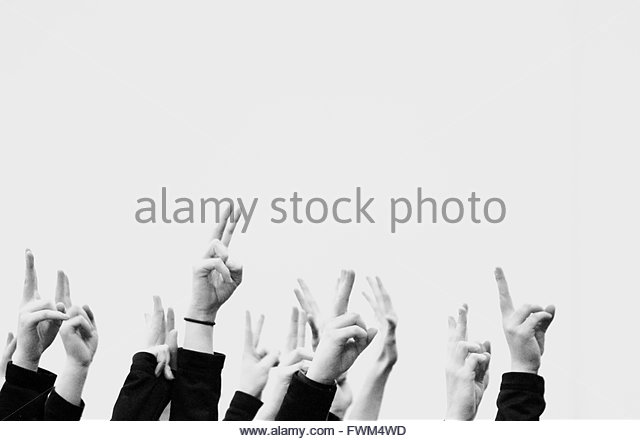 Cropped Image Of People Showing Victory Sign Against Clear Sky - Stock-Bilder