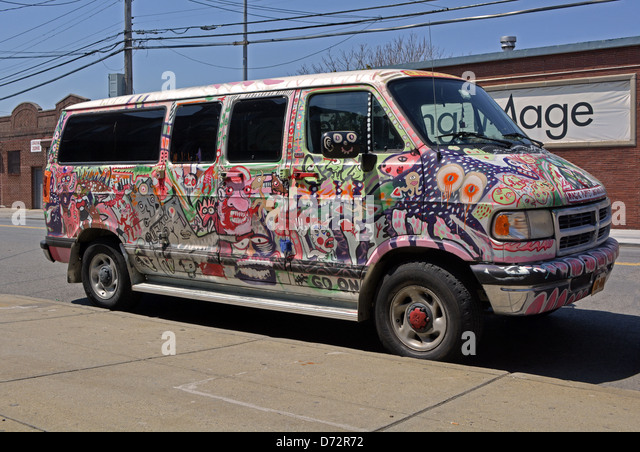 MInivan completely painted with graffiti in Woodside Queens, New York - Stock Image