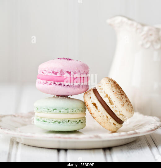 Pastel macarons on a plate - Stock Image