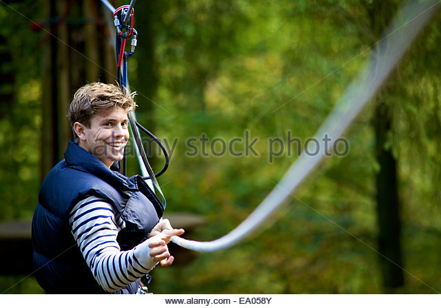 Outdoor sports and adventure tree climbing - Stock Image