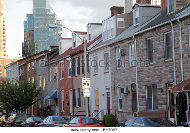Maryland Baltimore Little Italy ethnic neighborhood row house brick Formstone contrast high-rise traffic sign speed - Stock Image