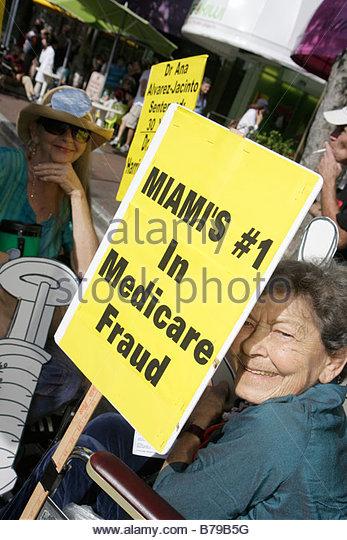 Miami Coconut Grove Florida King Mango Strut annual community event parade satire parody sign poster woman senior - Stock Image