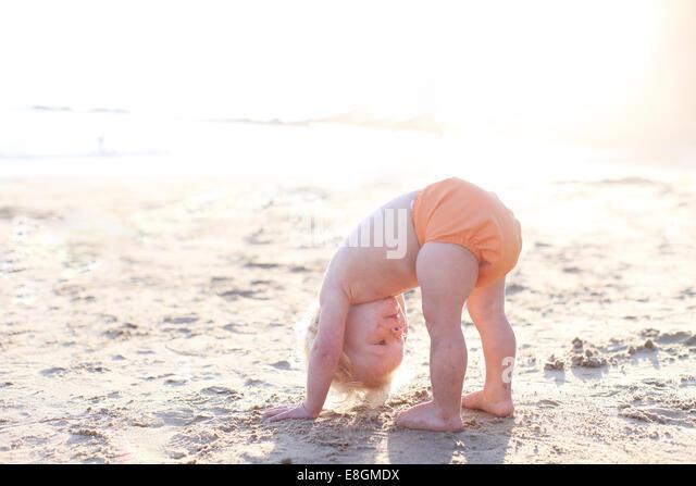 Side view of toddler bending down - Stock-Bilder