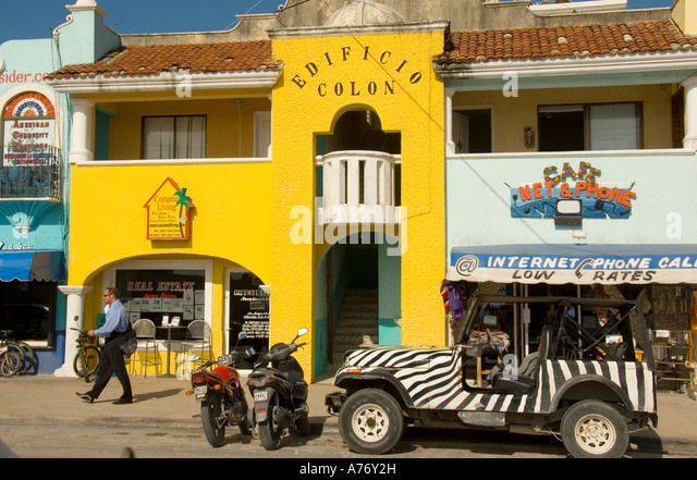 Cozumel Mexico San Miguel town skyline bright yelolw colorful buildings - Stock Image