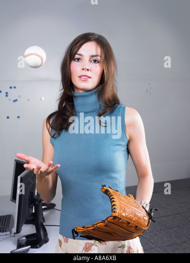 Woman with baseball and glove - Stock Image