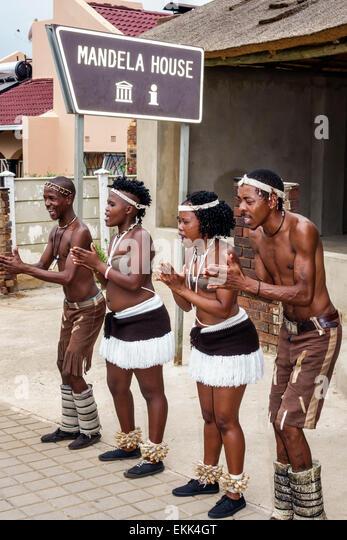 South Africa African Johannesburg Soweto Vilakazi Street Precinct Black man woman performers singing - Stock Image