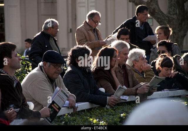 grimace, Turf, gambler,hope, loser, public, sad, sunny day, disappointment, expectation - Stock Image