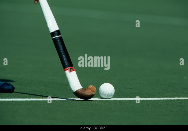 Field hockey stick and ball - Stock Image