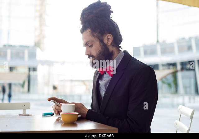 Stylish elegant dreadlocks businessman at the bar in business landscape - Stock-Bilder