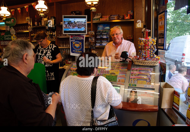 Customers in a Peronne cafe playing the French national lottery - Stock Image