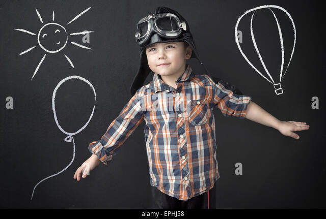 Small clever man as a pilot - Stock Image