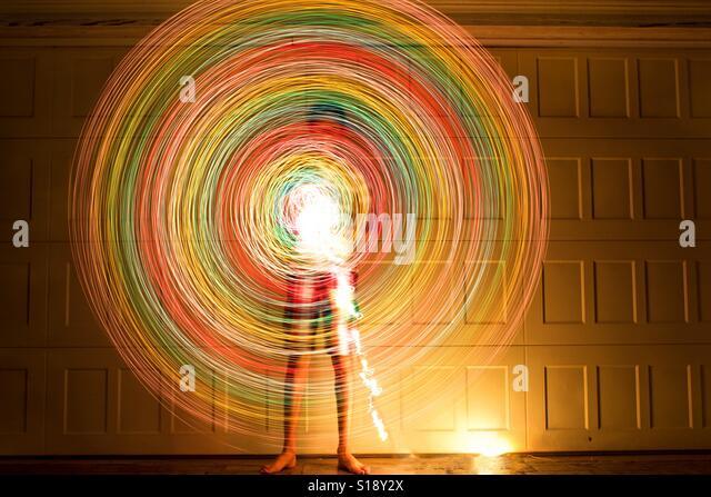 Boy spinning lights leaving light trails - Stock-Bilder