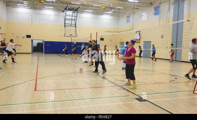 People practicing volleyball at a gym in Canada - Stock Image