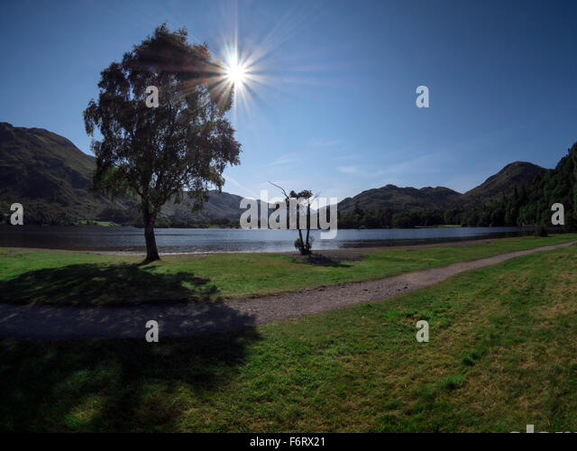 Late summer sunshine over Ullswater at Glenridding in the English Lake District - Stock Image