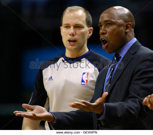 Orlando Magic head coach Jacque Vaughn (R) yells at official John Goble during the second half of their NBA basketball - Stock Image