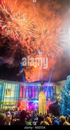 Woking, Surrey, UK. 19th November, 2015. Colourful fireworks as the annual Christmas lights are switched on in the - Stock Image